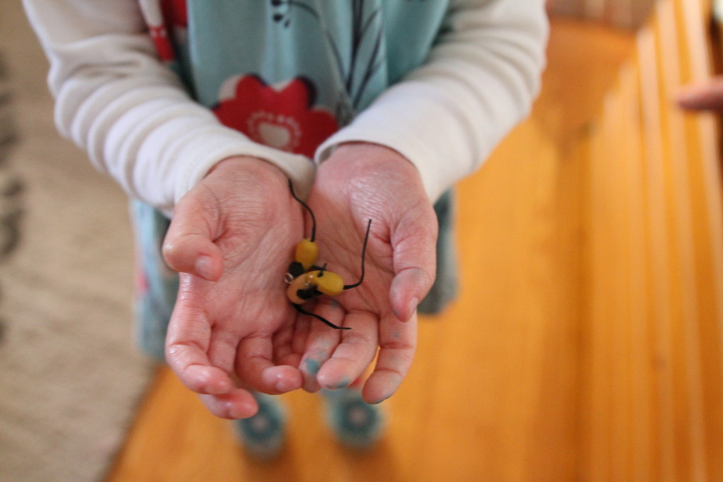 My daughter holding little mice buttons I picked up at Dublin Bay Knitting. They are just too cute!
